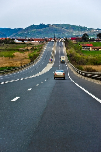 Various vehicles travelling down straight highway