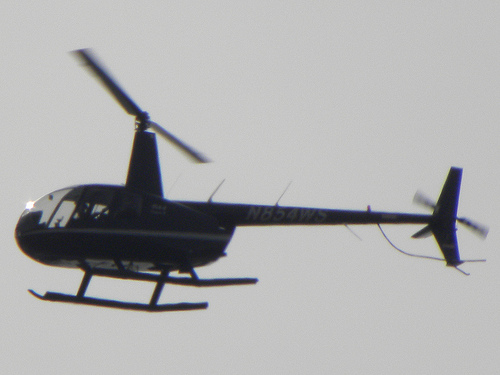 Helicopter N854WS above an anti-war protest